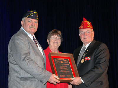 Department Of Indiana Homeless Veterans Chairman (Russ Bensheimer) and Department Auxiliary President (Phyliss Clark) receive the first ever National Homeless Veterans Outreach award from National Commander Tom Cadimus of Michigan.