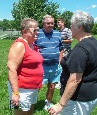 Carol Thompson visits with an old friend, Frank Threalkeld's daughter; Franklin 2004