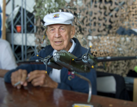 Doolittle Raider Richard E. Cole at 2009 Reading Air Show in Pennsylvania.  He was Lt. Col. Jimmy Doolittle's co-pilot for the legendary April 18, 1942,  bombing of Tokyo by 16 carrier-launched B-25 Mitchells.  This first attack on Japan came less than five months after Pearl Harbor and shocked the Japanese.  In foreground is a model of the medium bomber.