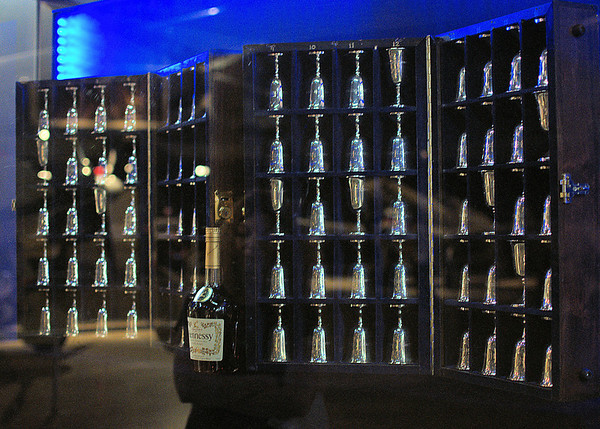 Toasting the Doolittle Raid.  These 80 sterling goblets honor the aircrew who took part in the April 18, 1942, bombing of the Tokyo area.    At each of their annual reunions, the Raiders honor those who have died and whose goblets are turned upside down. You also see a bottle of cognac, vintage 1896, the year of Jimmy Doolittle's birth, that is to be drunk by the last two Raiders at the last reunion.  They are housed in a portable wooden case made by Raider Richard Cole and on display at the National Museum of the U.S. Air Force in Dayton, Ohio. In 2010, eight goblets were still upright.
