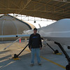 Standing next to the Predator Unmanned Aerial Vehicle, Ali al Saleem, Kuwait, 2002.