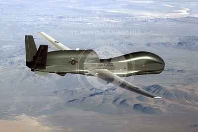 An RQ-4 Global Hawk soars through the sky to record intelligence, surveillence and reconnaissance data.