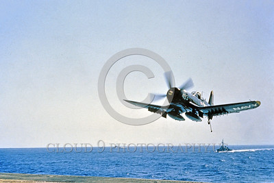 F4U-USN 0002 A dark blue Chance Vought F4U Corsair USN WWII era fighter shown makes a gear up tailhook down landing approach to an aircraft carrier circa mid-1940's USN photo via Tailhook Col  produced by Cloud 9 Photography     DONEwt