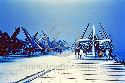 F4U-USN 0003 Static dark blue Chance Vought F4U Corsairs, USN WWII era fighter, on a snow covered aircraft carrier flight deck, circa mid-1940's, USN photo via Tailhook Col  produced by Cloud 9 Photography     DONEwt