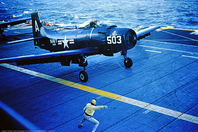A-1USN-VA-145 0001 A dark blue Douglas A-1 Skyraider USN attack aircraft VA-145 RUSTLERS ready to take-off from an aircraft carrier circa early 1950's official USN photograph via Tailhook Col  produced by Cloud 9 Photography     DONEwt