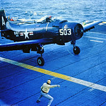 A-1USN-VA-145 0001 A dark blue Douglas A-1 Skyraider USN attack aircraft VA-145 RUSTLERS ready to take-off from an aircraft carrier circa early 1950's official USN photograph via Tailhook Co ...