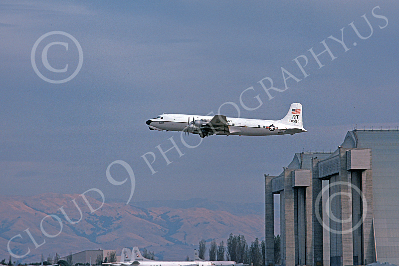 C-118USN 00024 A flying Douglas C-118B Liftmaster USN 131594 VR-53 CAPITAL EXPRESS RT code NAS Moffett 11-1975 military airplane picture by Michael Grove, Sr