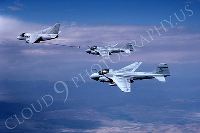 A-6USN 00300 Two USN Grumman A-6 Intruders refuel from a USN Lockheed S-3 Viking 7-1988 airplane picture by Robert L Lawson