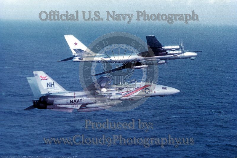 VF-114 F-14A from USS Enterprise (CVN-65) CVW-11 loaded with sparrow and sidewinger intercepts a Russian  Bear in 1982 in WestPac.<br /> USN<br /> Rick Berg