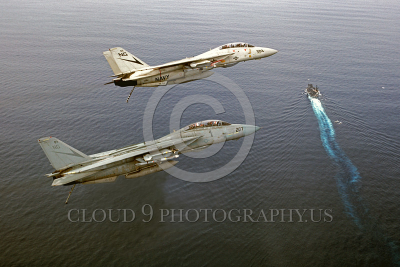 F-14USN-VF-24 0004 Two Grumman F-14 Tomcats USN jet fighter VF-24 FIGHTING RENEGADES with missiles fly over an aircraft carrier military airplane picture by Peter J Mancus