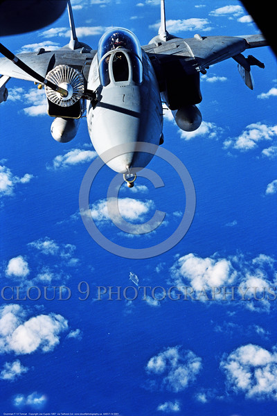 AAR-F-14 0001 A Grumman F-14 Tomcat USN swing wing jet fighter refuels over the ocean from a KC-10 by Joe Cupido via the Tailhook Col  produced by Cloud 9 Photography     DONEwt