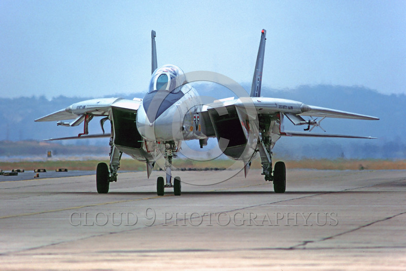 F-14USN-VF-51 0001 A taxing Grumman F-14 Tomcat USN jet fighter VF-51 SCREAMING EAGLES USS Kitty Hawk NAS Miramar military airplane picture by Peter J Mancus