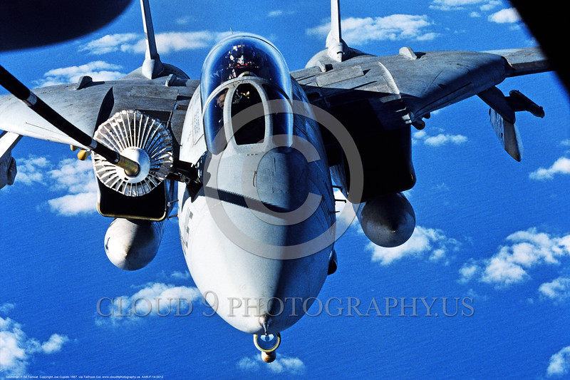 AAR-F-14 0012 A Grumman F-14 Tomcat USN swing wing jet fighter refuels over the ocean from a KC-10 by Joe Cupido via the Tailhook Col  produced by Cloud 9 Photography     DONEwt