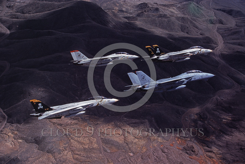 F-14USN-VF-84 0016 Four flying Grumman F-14 Tomcats USN VF-84 THE JOLLY ROGERS and VF-41 BLACK ACES 4-1990 military airplane picture by Robert L Lawson