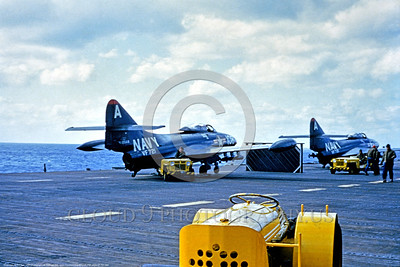 F9F-USN-VF-721 003 Two dark blue Grumman F9F Panthers USN jet fighters on the deck of an aircraft carrier circa mid-1950's USN photo via Tailhook Col  produced by Cloud 9 Photography     DONEwt