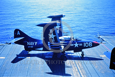 F9F-USN-VF-721 001 A dark blue Grumman F9F Panther USN jet fighter 173643 with rockets and folded wings on an aircraft carrier circa mid-1950s USN photo via Tailhook Col  produced by Cloud 9 Photography     DONEwt