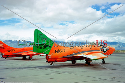 "Drone-QF-9-USN 004 A static green and faded orange Grumman QF-9G Cougar USN 128152 ""CHINA LAKE REDBIRD"" drone target NAS Chine Lake 3-1967 military airplane picture by Clay Janson    DONEwt"