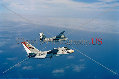 S-3USN-VS-21 002 A flying Lockheed S-3A Viking USN anti-submarine warfare airplane VS-21 FIGHTING REDTAILS USS Constellation NG tail code with Grumman S-2 Tracker USN VS-37 SAWBUCKS 5-1977 military airplane picture by Robert L Lawson     Dwt