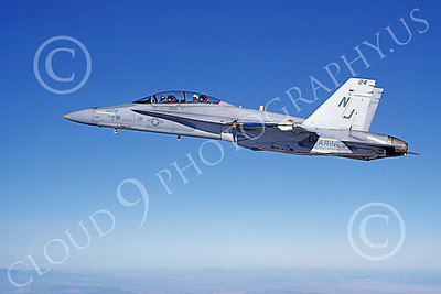 McDonnell Douglas TF-18A-USN 00002 A flying McDonnell Douglas TF-18A Hornet USN VFA-125 ROUGH RAIDERS 2-1982 military airplane picture by Robert L Lawson