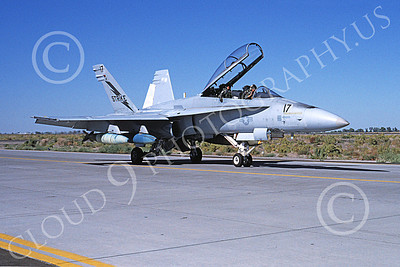 McDonnell Douglas F-18B-USN 00021 A taxing McDonnell Douglas F-18B Hornet USN STRIKE with bomb NAS Fallon 9-1993 military airplane picture by Michael Grove, Sr