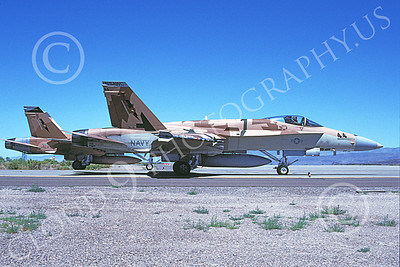 TOPG 00067 Two taxing brown McDonnell Douglas F-18A Hornet USN 162906 TOP GUN NAS Fallon 6-2000 military airplane picture by Michael Grove, Sr