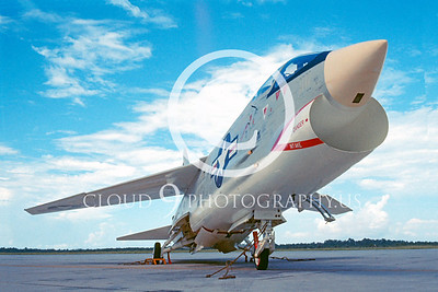 """This US Navy Vought F-8 CRUSADER jet fighter, by me, is, to me, worthy of a """"Peter's Picks"""" selection for a combination of these reasons: 1) It is 100% clutter free--no distractions; 2) it is an excellent representation of what I call """"complex simplicity"""", meaning, it is simple in its presentation, albeit in a subtle, complex way, namely, all distracting fire bottles, etc., were removed, first, to """"clean up"""" the picture, plus, a most pleasing angle was chosen that is well suited for this particular jet fighter; 3) it is an arty or artistic type modest wide-angle picture with excellent depth of field; 4) the angle of the plane leads one's eye into the frame; and 5) the moderate amount of clouds are a lovely bonus and accent. -- Peter Mancus"""