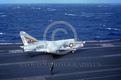 A-7USN-VA-105 0001 A Vought A-7E Corsair II USN attack jet 157553 VA-105 GUNSLINGERS commanding officer's airplane taxis  on USS Saratoga 10-1977 military airplane picture by Paul Marsh