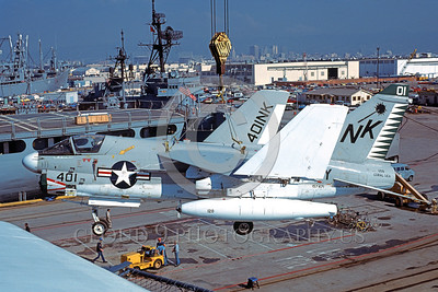 A-7USN-VA-27 0001 A Vought A-7E Corsair II USN 157471 VA-27 ROYAL MACES is lifted by a crane onto the USS Coral Sea 11-1979 military airplane picture by Michael Grove, Sr
