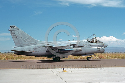 A-7USN-VA-46 0001 A taxing Vought A-7E Corsair II USN attack jet 159268 VA-46 CLANSMEN USS John F Kennedy NAS Fallon 8-1989 military airplane picture by Michael Grove, Sr