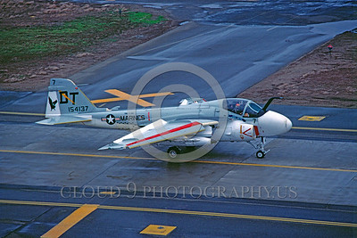 A-6USMC-VMA(AW)-242 00001 A taxing Grumman A-6 Intruder USMC attack jet 154137 VMA(AW)-242 BATS DT code McClellan AFB 3-1982  military airplane picture by Peter J Mancus
