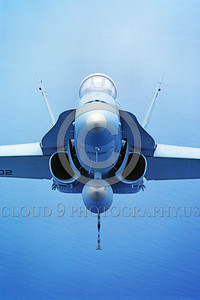 F-18USMC-Generic 0001 A head-on view of a flying McDonnell Douglas F-18A Hornet USMC jet fighter by Peter J Mancus