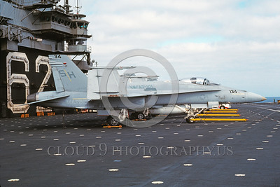 F-18USMC-VMFAT-101 0009 A static McDonnell Douglas F-18A Hornet USMC 163717 VMFAT-101 SHARPSHOOTERS on USS Independence 8-1989 military airplane picture by Rick Morgan