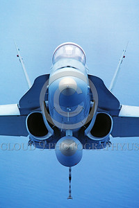 F-18USMC-Generic 0003 A head-on view of a flying McDonnell Douglas F-18A Hornet USMC jet fighter by Peter J Mancus