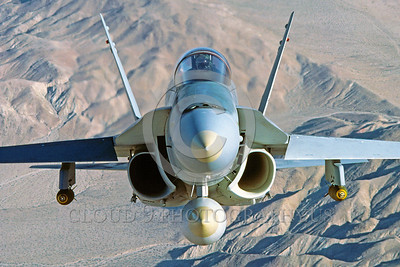 F-18USMC-Generic 0022 A flying McDonnell Douglas F-18A Hornet USMC jet fighter with bombs military airplane picture by Peter J Mancus