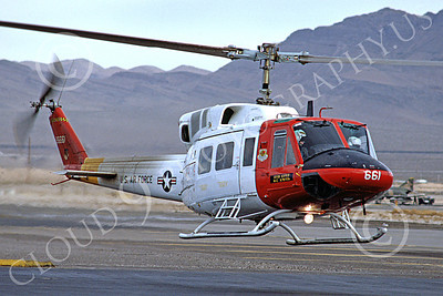 H-1USAF 00001 A hoovering Bell H-1 Iroquois Huey USAF helicopter Nellis AFB 11-1985 by Peter J Mancus