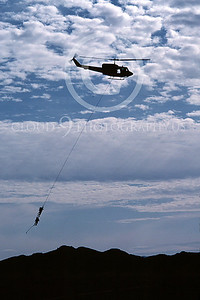 H-1USMC 00005 A flying Bell UH-1 Iroquois Huey dangles two US Marines 3-1982 helicopter picture by Peter J Mancus