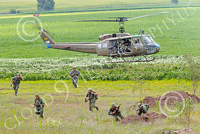 H-1USA 00008 A Bell H-1 Iroquois Huey US Army with disembarked soldiers military helicopter picture by Peter J Mancus