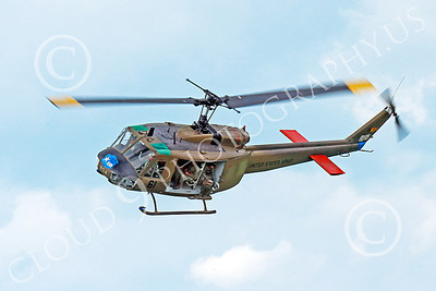 H-1USA 00012 A flying banking Bell H-1 Iroquois Huey US Army military helicopter picture by Peter J Mancus