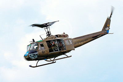 H-1USA 00014 A flying Bell H-1 Iroquois Huey US Army military helicopter picture by Peter J Mancus