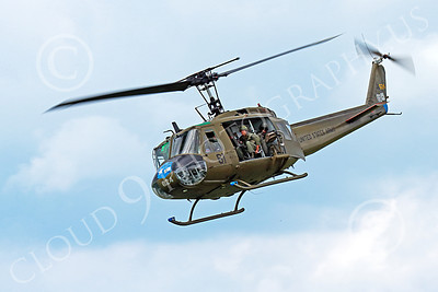 H-1USA 00021 A flying Bell H-1 Iroquois Huey US Army military helicopter picture by Peter J Mancus