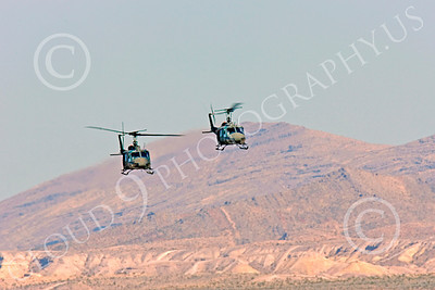 H-1USA 00016 Two flying Bell H-1 Iroquois Huey US Army helicopters by Peter J Mancus
