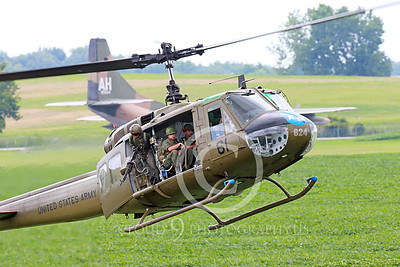 H-1USA 00005 A common scene during the Vietnam War years, a flying Bell H-1 Iroquois Huey US Army military helicopter picture by Peter J Mancus