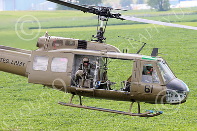 H-1USA 00025 A flying Bell H-1 Iroquois Huey with open doors US Army military helicopter picture by Peter J Mancus
