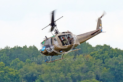 H-1USA 00003 A classic Huey picture--flying near the tree line, jinking, a Bell H-1 Iroquois Huey US Army military helicopter picture by Peter J Mancus