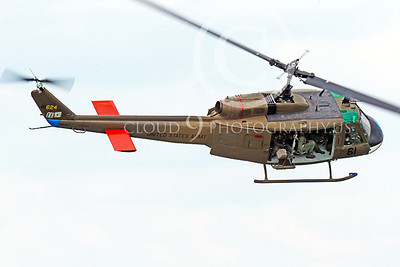 H-1USA 00013 Top view of a flying Bell H-1 Iroquois Huey US Army military helicopter picture by Peter J Mancus