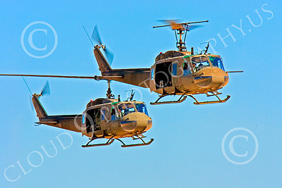 H-1USA 00018 Two flying Bell H-1 Iroquois Huey US Army helicopters by Peter J Mancus