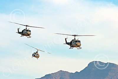H-1USA 00022 Three flying Bell H-1 Iroquois Huey US Army helicopters by Peter J Mancus