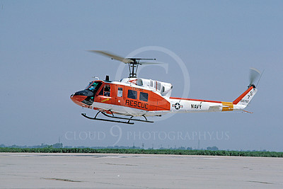 H-1USN 00006 A flying Bell UH-1 Iroquois Huey USN 8-1989 helicopter picture by Peter J Mancus