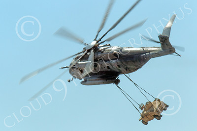 CH-53EUSMC 00030 A flying USMC Sikorky CH-53E Super Stallion with a slinged load turns left, military helicopter picture, by Peter J Mancus