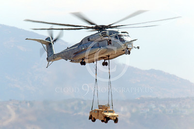CH-53EUSMC 00042 A USMC Sikorsky CH-53E Super Stallion airlifts a military vehicle, helicopter picture, by Peter J Mancus